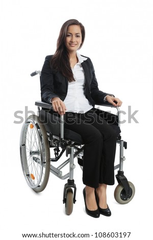 Asian Businesswoman sitting in a wheel chair isolated on white - stock photo