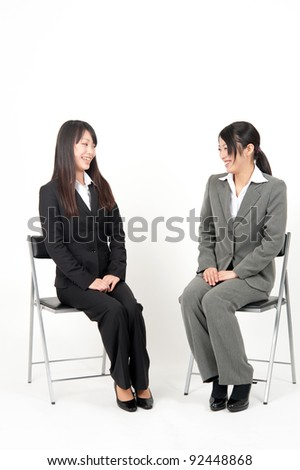 asian businesswoman sitting isolated on white background - stock photo
