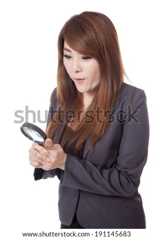 Asian businesswoman surprised use magnifying glass looking down isolated on white background - stock photo
