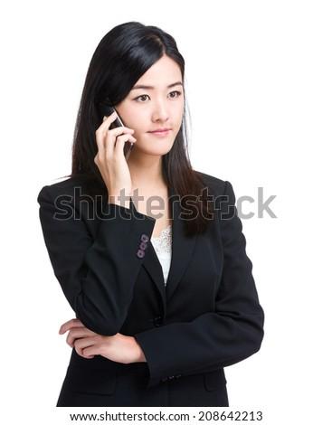 Asian businesswoman talk on mobile phone - stock photo