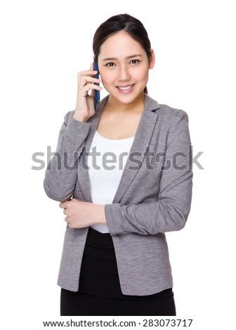 Asian businesswoman talk to mobile phone - stock photo