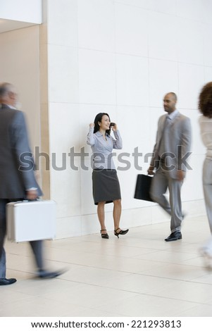 Asian businesswoman talking on cell phone - stock photo