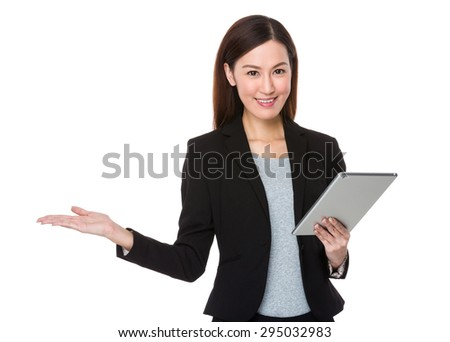 Asian Businesswoman use of the tablet pc and open hand palm - stock photo