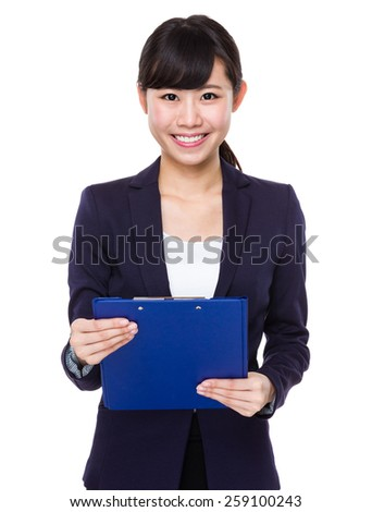 Asian businesswoman with diary - stock photo