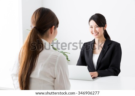 asian businesswomen working in the office - stock photo