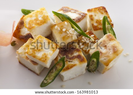 Asian cheese stir fried on fry pan - stock photo