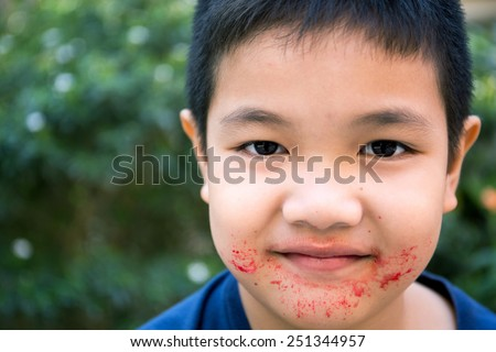 Asian child eating eat sweets and look very cheerful and happy - stock photo