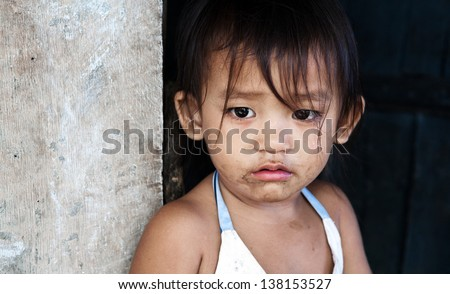Asian child from impoverished area - stock photo
