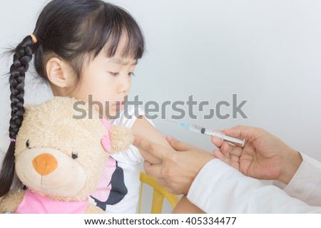 asian child have vaccination - stock photo