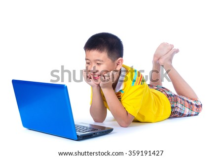 Asian child in yellow t-shirt using a blue laptop, on white background, isolated - stock photo