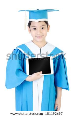Asian Child with tablet computer in Congratulations Kindergarten graduation uniform . - stock photo