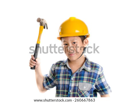 Asian child with yellow helmet and hammer - stock photo