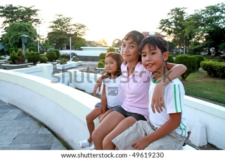 asian children enjoying at the park - stock photo