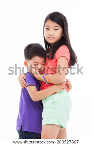 Asian children_Sister care his sadness isolated on white. - stock photo