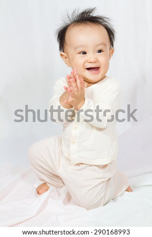 Asian Chinese baby smalling in white background - stock photo