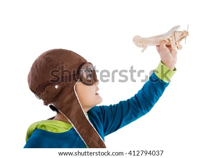 Asian Chinese Boy Playing with Wooden Airplane in isolated White Background - stock photo