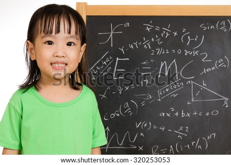 Asian Chinese children againts blackboard or chalkboard with formulas in plain isolated white background. - stock photo