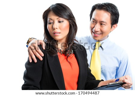 Asian Chinese Employee or secretary getting manager or business man sexual harassed or harassment and reject him - stock photo