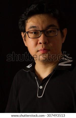 Asian Chinese Guy Portrait in dark background studio shots. - stock photo