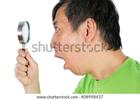 Asian Chinese Man Looking through a Magnifying Glass in isolated White Background - stock photo