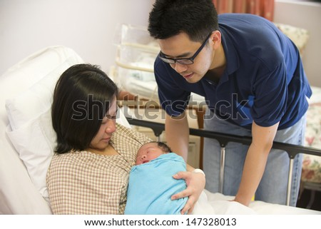 Asian chinese newborn baby girl and daddy in hospital  - stock photo
