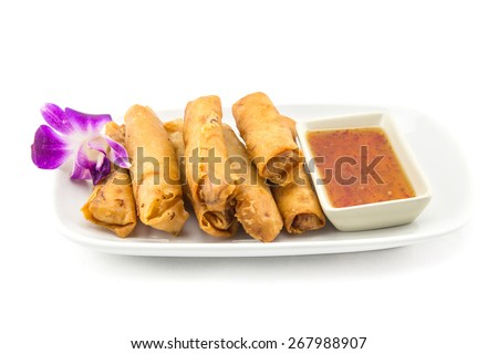 Asian chinese spring rolls with sauce - stock photo