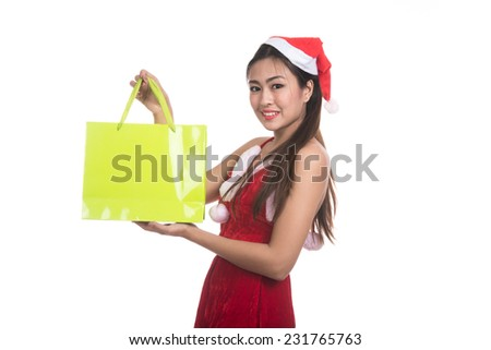 Asian Christmas girl hold shopping bags,sale, gifts, christmas, x-mas concept - smiling woman in red shirt and santa helper hat with shopping bags,isolated on white background - stock photo