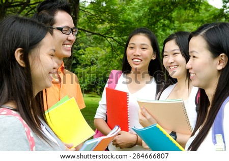 Asian college students having discussion - stock photo