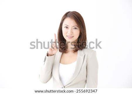 Asian corporate officer with finger point out - stock photo