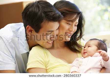 Asian couple and baby - stock photo