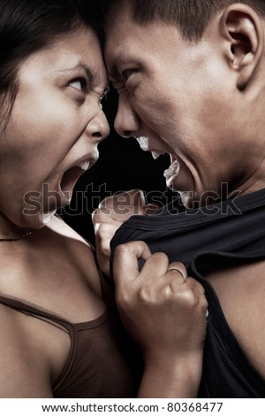 Asian couple having quarrel with physical contact - stock photo