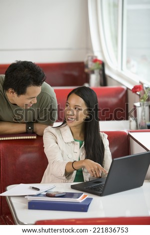 Asian couple smiling at each other - stock photo