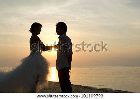 Asian couple with pre wedding sceen out door background. - stock photo
