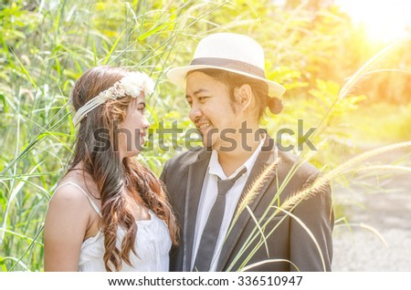 Asian couple with pre wedding sceen out door tree background.,asian lover - stock photo