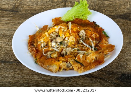 Asian cuisine - Omelet with oysters  - stock photo