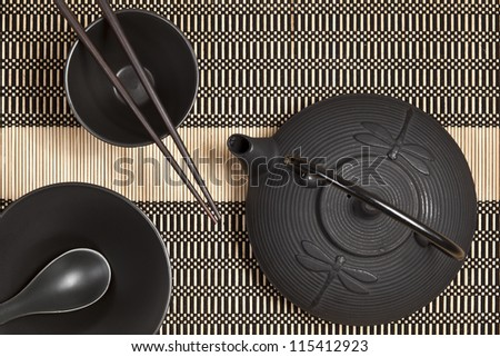 Asian cups and teapot - stock photo
