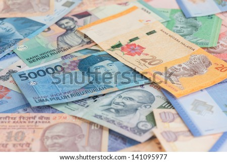 Asian currencies background of India, Indonesia and Malaysia - stock photo