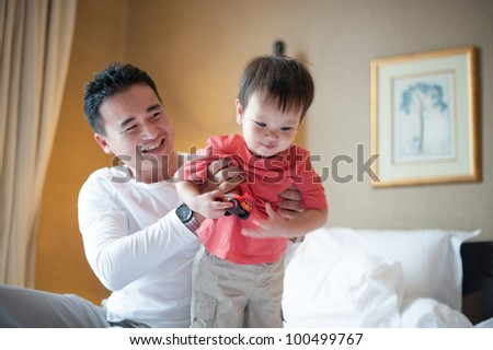 Asian dad with kid - stock photo