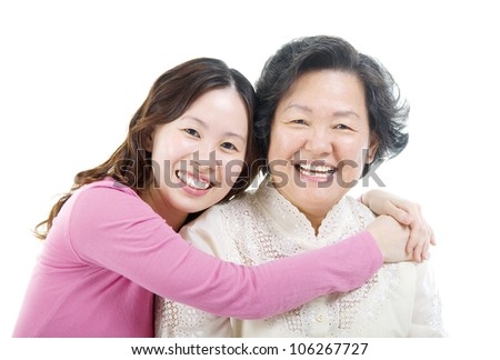 Asian daughter hugging her mother - stock photo
