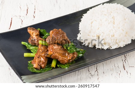 Asian dish with white rice and vegetables  - stock photo