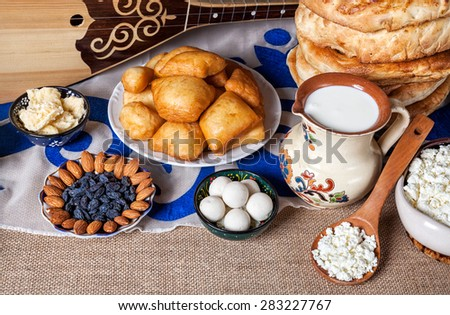 Asian dishes and Dombra Kazakh instrument on the table - stock photo