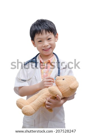 Asian doctor boy playing and cure  bear toy isolated on white background - stock photo