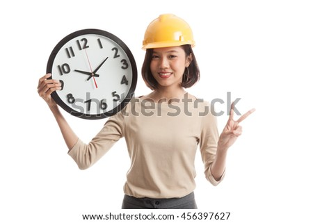 Asian engineer woman show victory sign with a clock  isolated on white background - stock photo
