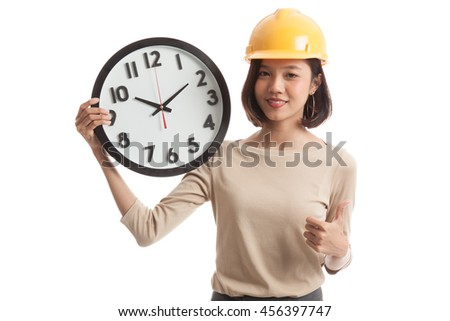 Asian engineer woman thumbs up with a clock  isolated on white background - stock photo