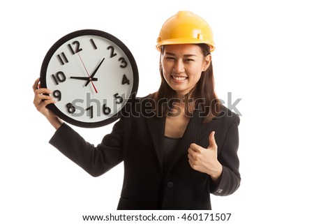 Asian engineer woman thumbs up with a clock  isolated on white background. - stock photo