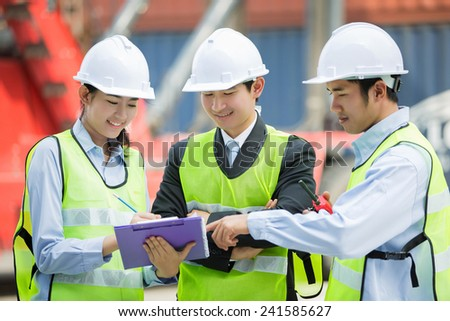 Asian engineers were consulted together and plan - stock photo