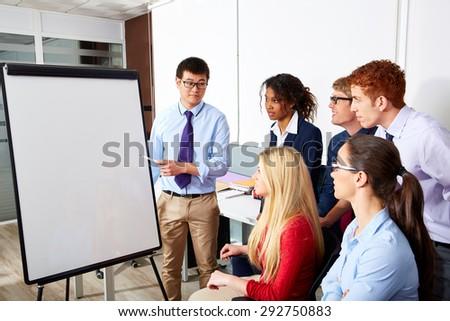 Asian executive businessman presentation to office team - stock photo