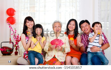 Asian family celebrating chinese new year - stock photo