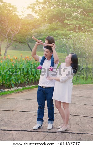 Asian family having morning walk in the beautiful sunshine - stock photo