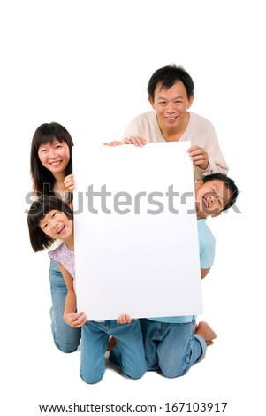 Asian family holding a white board - stock photo